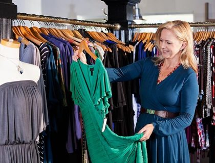 A woman hold the frock in shop